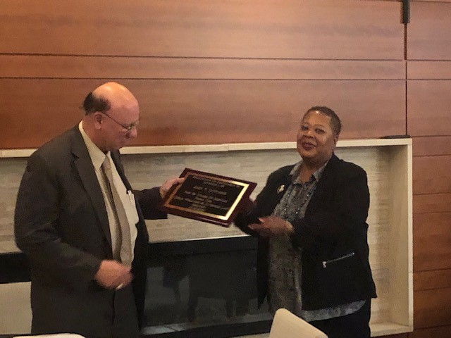 John DiStassio accepting a plaque of recognition.