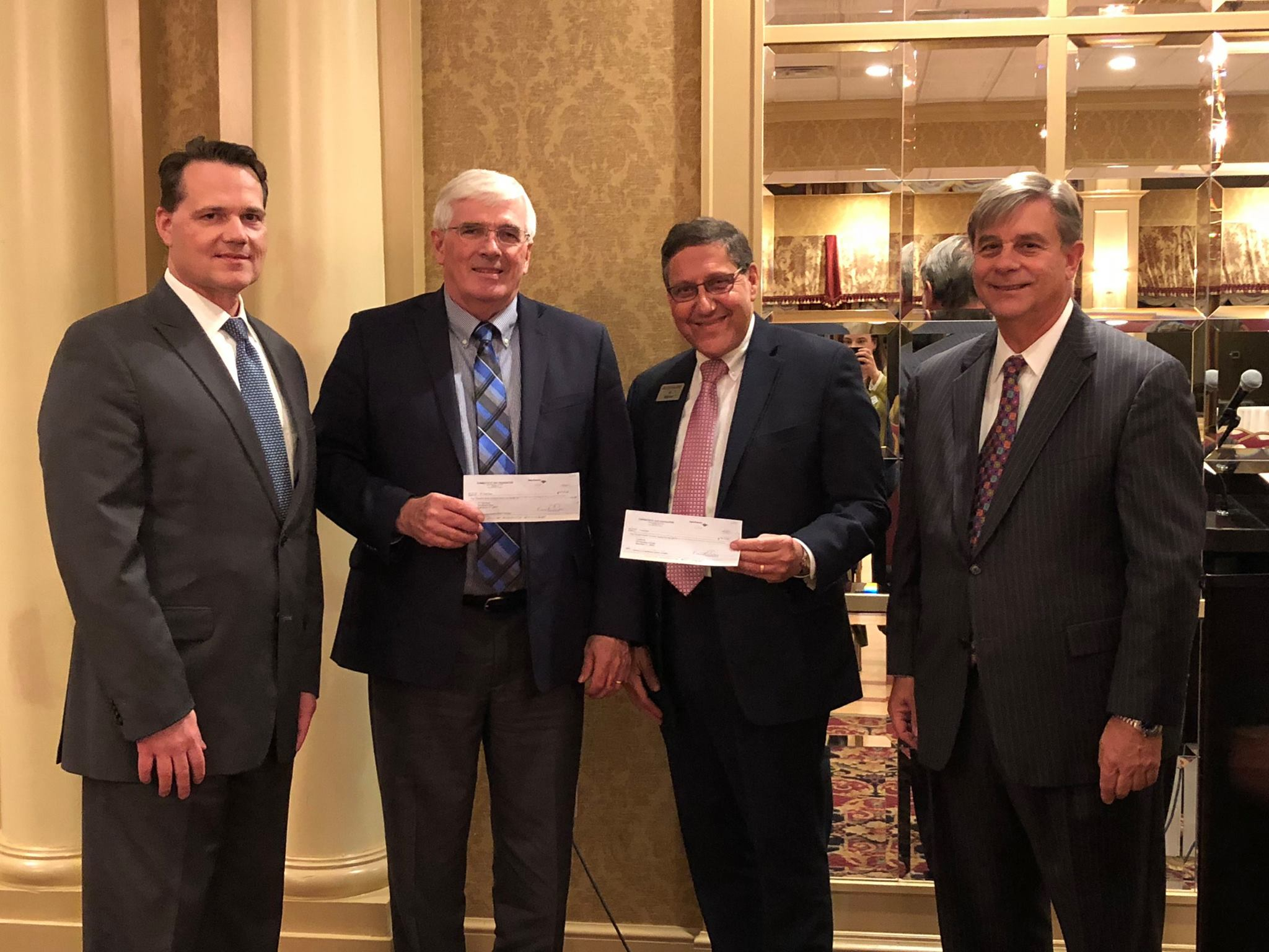 (L to R) Workers' Compensation Section Chair Francis X. Drapeau, Connecticut Food Bank Chief Executive Officer Bernard J. Beaudreau, Foodshare Corporate and Community Giving Manager Al Marino, and Charity Golf Committee Chair Richard L. Aiken, Jr.