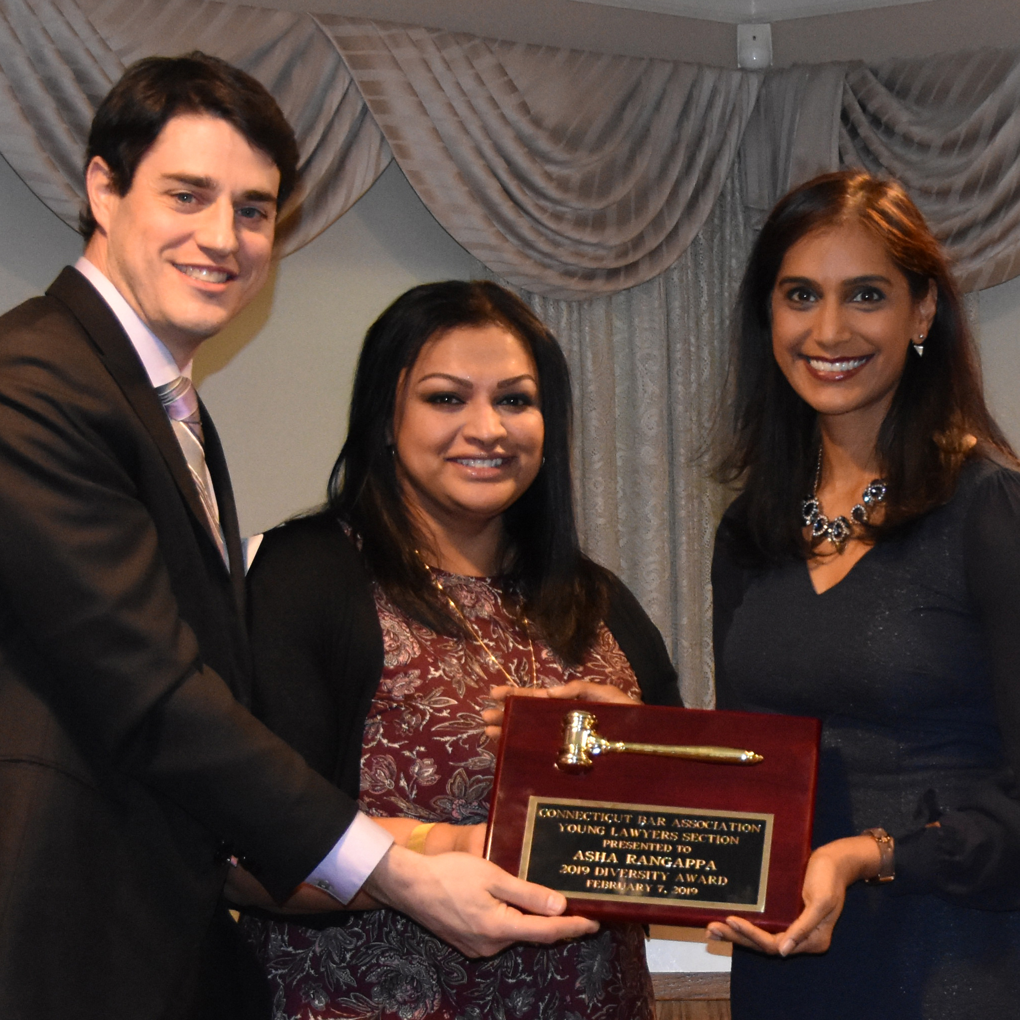 YLS Chair David A. McGrath, YLS Senior Advsior Suphi A. Philip, and Diversity Award recipient Asha Rangappa