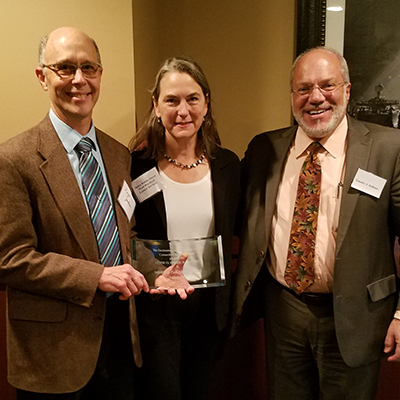 Douglas Jackson and Helen Rubino-Turco accept the Environmental Law Section's Clyde O. Fisher, Jr. Award from Timothy S. Hollister.