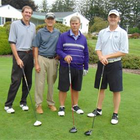 Lucas D. Strunk, Richard S. Bartlett, Event Chair Richard L. Aiken, Jr., and Erik S. Bartlett play in the 20th Annual Verrilli-Belkin Workers' Compensation Charity Golf and Dinner Event. Photo taken Kenneth B. Katz.